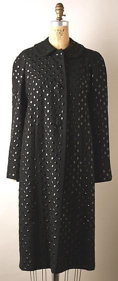 Black evening coat with paillettes, by Norman Norell, American, 1941. Worn with silk net dress with paillettes.
