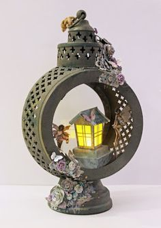 Altered mixed media fairy lamp made for Kaisercraft. This is made with the Fairy dust collection. The small lantern inside the lamp is Kirstens design and is made with a Silhouette. The lamp is from Rusta. Made by Kirsten Hyde