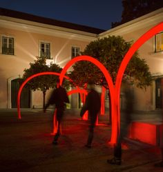 Red Lighting Installation in Lisbon  Portuguese studio LIKEarchitects did an ephemeral installation of red LED lights in the gardens of th...