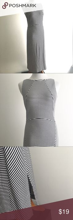 """Banana Republic Long Black & White Striped Dress 2 Black and white sleeveless dress by Banana Republic. Horizontal stripes down center with diagonal stripes on the side, making it very figure flattering. Stretchy, one side slit, back zipper. Size 2. Measures 12"""" shoulder to shoulder, 15.5"""" armpit to armpit, 12.5"""" across the waist, 16"""" across the hips, 42"""" long.   Shipped same/next day from a smoke-free home  All proceeds go towards the spay-neuter-care of a small colony of community cats…"""