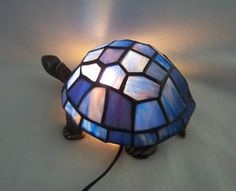 How rad, I don't like turtles but... https://www.etsy.com/listing/176356722/stained-glass-turtle-lamp