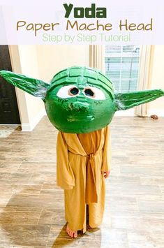 Learn how to make a Star Wars Yoda Paper Mache Head for Halloween with this step by step tutorial. Click photo for full tutorial.   www.thisolemom.com #Yoda #jedi #starwars #papermache #papermachecrafts #halloween #halloweencostumes #diy #diycrafts