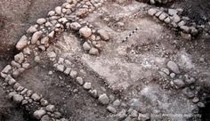 """10,000-Year-Old House and Cult Temple Found in Israel Archaeologists made an incredible discovery at a construction site in Israel when they unearthed the oldest dwelling to date in the Judean Shephalah, along with a """"cultic"""" temple, and a number of artefacts including a cluster of flint and limestone axes, some of which date back around 10,000 years."""
