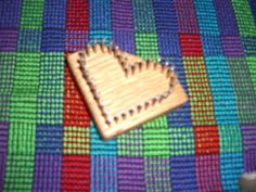 Lil Weaver Heart Loom - Great loom for embellishments - their site has videos for hearts, flowers and butterflies woven on this loom.