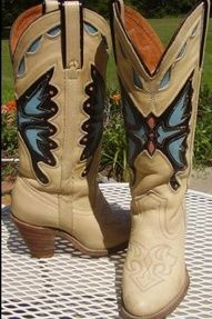 I have a pair of these in purple and dark brown leather! Love me some butterfly cowboy boots