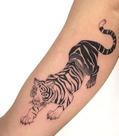 Wild animals are one of the most popular themes for tattooing. Tigers are quite favorite among men as the theme of a tattoo. Below, we are going to mention crouching tiger tattoo ideas and designs. Band Tattoos, Dope Tattoos, Badass Tattoos, Pretty Tattoos, Beautiful Tattoos, New Tattoos, Body Art Tattoos, Small Tattoos, Tattoos For Guys