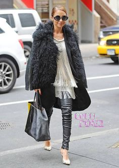Nicole Richie - snug-looking shearling coat worn over a Flapper Girl-style  fringed cream top fd9356d6f485