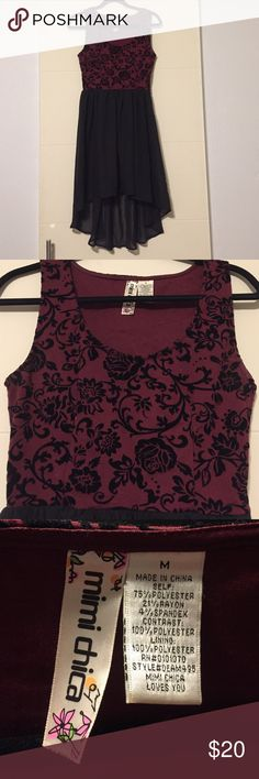 LNWOT Burgundy and Black Hi Lo dress in Size M This is a like new without tags dress from Mimi Chica in Size M that I purchased from Nordstrom. It has a burgundy colored top with a floral pattern in black velvet. It has a scoop neck and 2 inch thick straps. The skirt starts at the natural waist like and is a two layer liner and sheer overlay with a hi/lo hemline. It has a side zipper that works perfect and no wear, stains, or rips. I usually wear a size small and this is a size medium, so it…