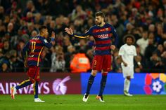 Gerard Pique of FC Barcelona celebrates with team-mate Neymar after scoring the opening goal during the La Liga match between FC Barcelona and Real Madrid CF at Camp Nou on April 2, 2016 in Barcelona