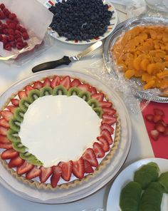 Assembling Fruit Pizza. See other pics for recipes. by Sarah DiGloria