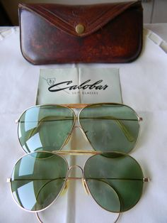 f74f41a0d5f6 Two Pairs of Vintage American Optical Calobar sunglasses AO 1 10 12K GF 40s  ww2. With original case.