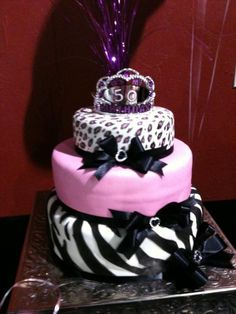 Heavenly Sweets Of Valrico - Special Occasions. 3 tiered pink, cheetah, and leopard print cake with black bows and tiara on top.