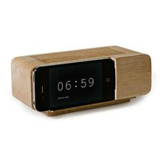 This $39 alarm clock doubles as an iPhone docking station that transforms your cell phone (running a flip clock app) into a retro wood alarm clock.