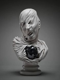 """This group of sculptures, named """"Ghosts Underground"""", depicts lost souls anguishing beneath the effect of a thin veil.  Scarpella's interest in this subject was inspired by a trip to the Sansevero Chapel in Naples, home to Antonio Corradini's """"Veiled Christ""""."""