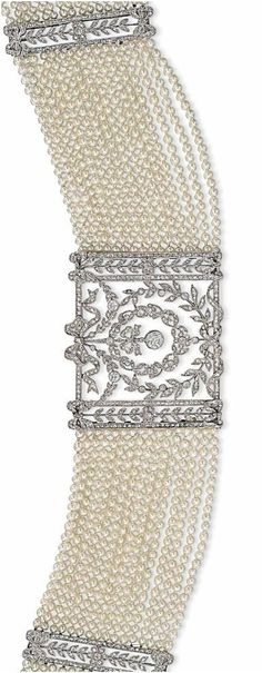 AN EARLY 20TH CENTURY PEARL AND DIAMOND CHOKER NECKLACE