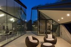 """A """"canyon"""" patio between two glass-wrapped sections of this home. Designed by http://www.bcarc.com/"""