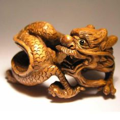 dragon netsuke.  This is close in colour and style of carving but my in a solid round ball