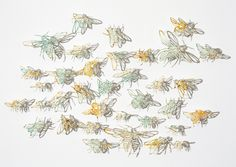 intricate artwork by claire brewster - she uses discarded materials, such as outdated maps and atlases, to create delicate cutouts and pins them in a box frame. light brings them to life