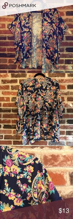 Paisley and Floral Kimono Lightweight and colorful kimono perfect for spring and summer. So many compliments received when wearing. 100% rayon. I'm usually weary about rayon materials, I've noticed it doesn't wrinkle nearly as bad as other rayon products. Francesca's Collections Tops