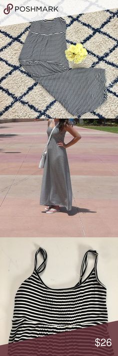 """Calvin Klein Striped Maxi Dress The perfect beach party dress.  Black with white strips.  Subtle pleated detail on bust with adjustable spaghetti straps. Very long... I'm 5'8"""" and it hits the top of my feet. ( this is me on the picture 😉)  Very good used condition.  Size 2 Approximately: 14"""" pit to pit  46"""" long  Feel free to ask questions 👌 Calvin Klein Dresses Maxi"""