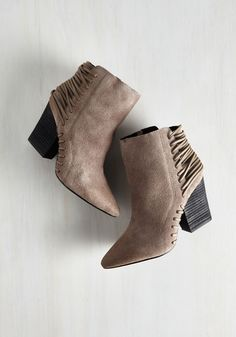 Impressively Edgy Bootie. Profoundly posh looks and arresting ensembles are your MO, so wowing onlookers with these suede booties by Mojo Moxy is only natural! #cream #modcloth