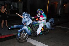 """HHN 17, Universal Studios Florida    One of the clowns from Halloween Horror Nights 17′s roving """"Motor Maniacs""""scaresquad cruises by on his unicorn-themed chopper.    Photo byD. Gerow."""