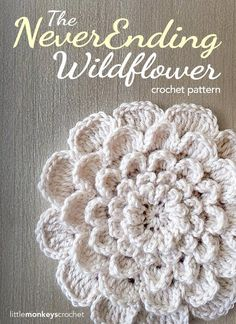 "I've got a great new flower pattern and tutorial for you! I've been brainstorming how to make a ""giant flower"" for a while, and I'm finally happy with what I've come up with. I'm loving this flower and am so exited about all of its potential uses.  What makes this flower ""never-ending"" is how it i"