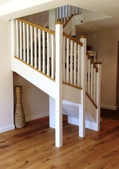 Double winder staircase comprising stop chamfered spindles and newels complimented with oak handrail base rail and pyramid newel caps, a perfect example of a white primed staircase. White Staircase, Winding Staircase, Wood Staircase, Stair Railing, Staircase Design, Staircase Ideas, Painted Staircases, Painted Stairs, Big Design