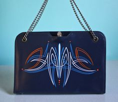 Navy blue vintage handbag with bright blue, white and orange pinstriping.