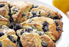 with blueberries and a lemon flavor, these no-fail Blueberry Lemon Scones will be your new favorite breakfast treat!Bursting with blueberries and a lemon flavor, these no-fail Blueberry Lemon Scones will be your new favorite breakfast treat! Blueberry Lemon Recipes, Blueberry Lemon Scones, Raspberry Scones, Blueberry Desserts, Blueberry Breakfast, Bakery Recipes, Cooking Recipes, Donuts, Homemade Buttermilk Biscuits