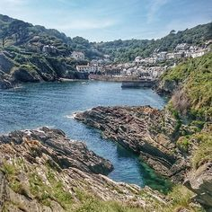 Polperro was made for days like these. Swimmers leaping from the harbour walls, white-washed fishersman's cottages dazzling the hillside and the English Channel sparkling shades of emerald to rival any of its European cousins. #whygoanywhereelse  .  .  .  .  .  #polperro #cornwall #looe #emerald #beautifuldestinations #holidayideas #doyoutravel #swisbest #guardiantravelsnaps #holiday #turquoise #sea #poldark #kernow #instagood #picoftheday #traveladdict #fisherman #toadhallcottages
