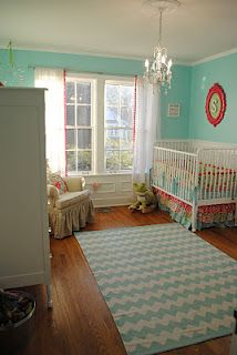Love the turquoise  and coral colors, chevron rug and ruffled bed skirt