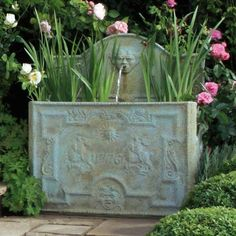 We love this classic styled garden water feature tank. Elegant water tank in a verdigris blue/green finish, with the antiqued detailing featuring scroll work and imagery of George and the Dragon, and with a date of 1776. This replica is made from high quality fibre glass and, with the distressed verdigris finish, the water tank looks as though it is an original piece dating from 1776. Unusual garden planters; water features for garden; antique garden Pond Plants, Water Plants, Water Pond, Garden Water, Water Gardens, Garden Fountains, Floating In Water, Water Conservation, Garden Planters