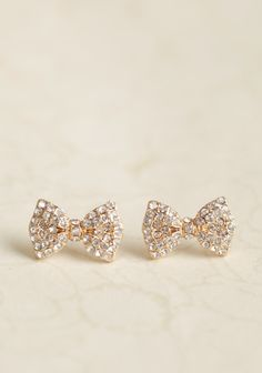 Dolled-up Bow Earrings 9.99 at shopruche.com. Perfected with classic rhinestones, these darling gold-toned bow studs add a charming touch to any outfit.0.75