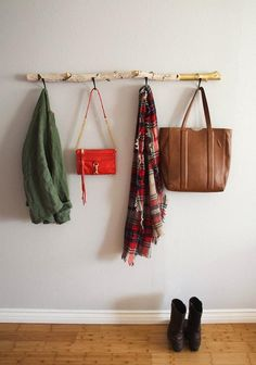 You can use natural materials to make the perfect coat rack for your front hallway, like this driftwood wall hanger.