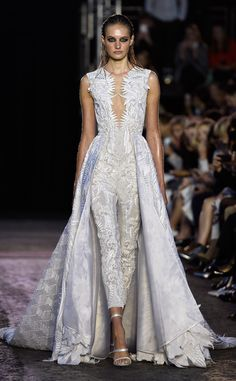 Julien Macdonald S/S 16: I love this white embroidered pantsuit with a gown/train. Unique and exquisite!