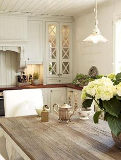 ♥ The Heartbook lovely cottage kitchen. Love the way they have used narrow depth base cabinets to maintain continuity