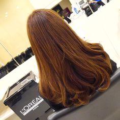 Honey brown Korean curls by STYLENA Hair Salon | Singapore