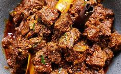 Beef Rendang is a flavorful West Sumatran dry curry that's made with beef, that's cooked together with a spice paste and coconut milk until fork-tender. Boneless Beef Short Ribs, Toasted Coconut, Coconut Milk, Beef Curry, Asian Recipes, Thai Recipes, Cooking For Two, Cooking Together, Food To Make