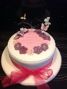 Floral birthday cake with wired butterflies