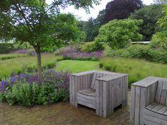 Another view in Scampston Hall walled garden (Piet Oudolf garden design, chairs by Dutch designer.