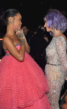 2015 Grammys - Rihanna & Katy Perry were Grammy performers, they are complimenting each other in a candid moment. at the event.