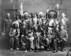 Cheyenne Indian Council at Pierre - South Dakota 1908. Standing from left to right: Major Bentley-Little Shield-Lone Eagle-Iron Lightning-Fish Gut-Charging First-G.H. Jaynes - seated: Brown Thunder-C.H. Engelsby-Governor Vessey-Colonel Frost-Yellow Owl-Interpreter Giles Tapetonwan/Tapeola - in front: Afraid of Enemy-Pust On His Shoes and White Bull