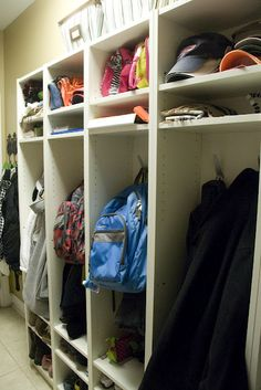 Create mudroom storage lockers with $34 IKEA Billy bookcases - just add hooks and set shelving to desired heights = BRILLIANT, {super easy & Affordable solution} ! :)