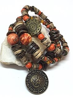 These 3 bracelets makes an exquisitely thoughtful gift. These bohemian stretch bracelets are crafted in a vibrant palette. Give this rustic boho bracelet as a symbol of thanks, friendship or affection. These earthy rustic bohemian bracelets are handmade with coconut shell beads, orange turquoise beads, seed beads, bronze beads, stretch cord, and bronze charms. These rustic bohemian bracelets would pair exceptionally well with earthtone outfits and can transition for day or evening wear…