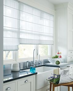 Create a feeling of lightness in a kitchen with sheer white Design Studio™ Roman Shades ♦ Hunter Douglas window treatments     #kitchen