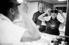 (6) Daughter's touching photographs chronicle her parents' joint battle with cancer: Knowing that it will soon fall out, Laurel lets her husband cut her hair late one evening.
