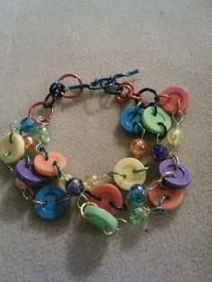 austism speaks button wire wrapped bracelet. $10.00, via Etsy.