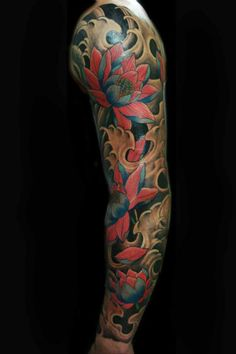 lotus sleeve tattoo this would be cute on my upper thigh since I would never get my arms done