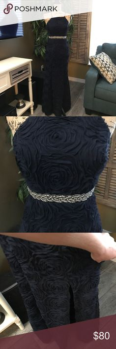 Navy blue formal dress So stunning and chic! My daughter wore this dress once for her junior prom last year. It kinda has a mermaid fit due to the slit that is just above the knee. Trixxi Dresses Prom